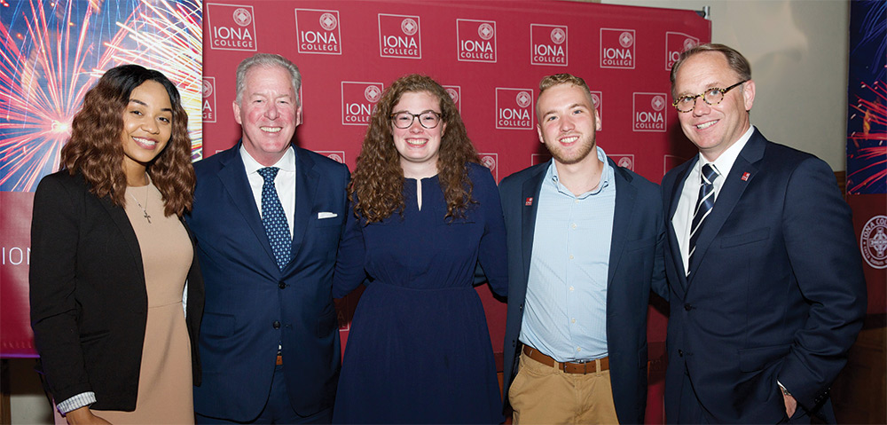 Angel Pierre, Dave McCabe, Hannah McGowan, Justin Pellegrino and President Nyre in front of Iona College banner.