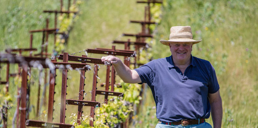 Joe Donelan smiling in his vineyard.