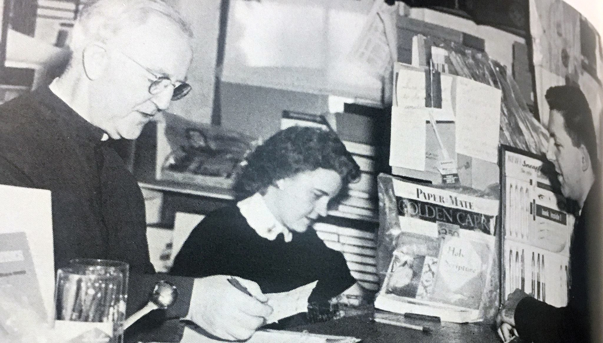 An old black and white of Brother Mulvaney and a nun working in the book store.