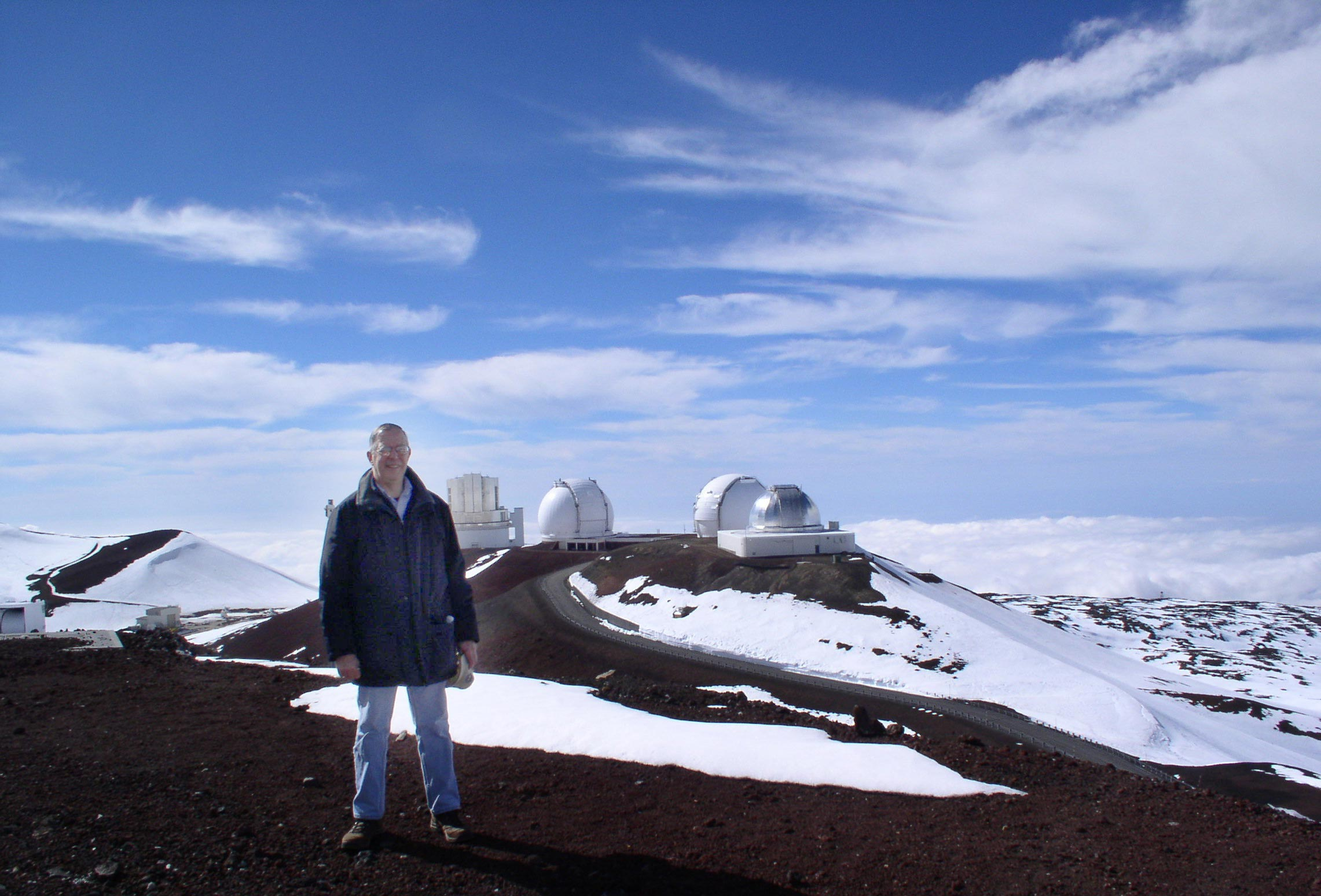 Brother Novak outside at the Mauna Kea Observatory.
