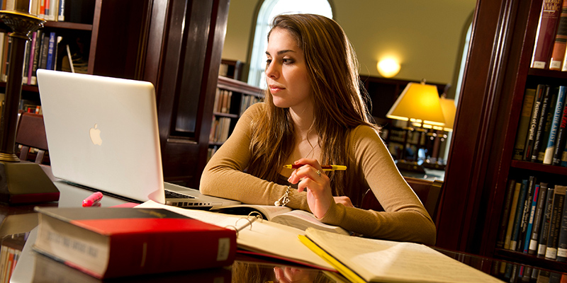 Student studying in library.