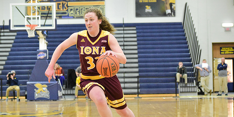 Tori Lesko playing for Iona dribbling down court.