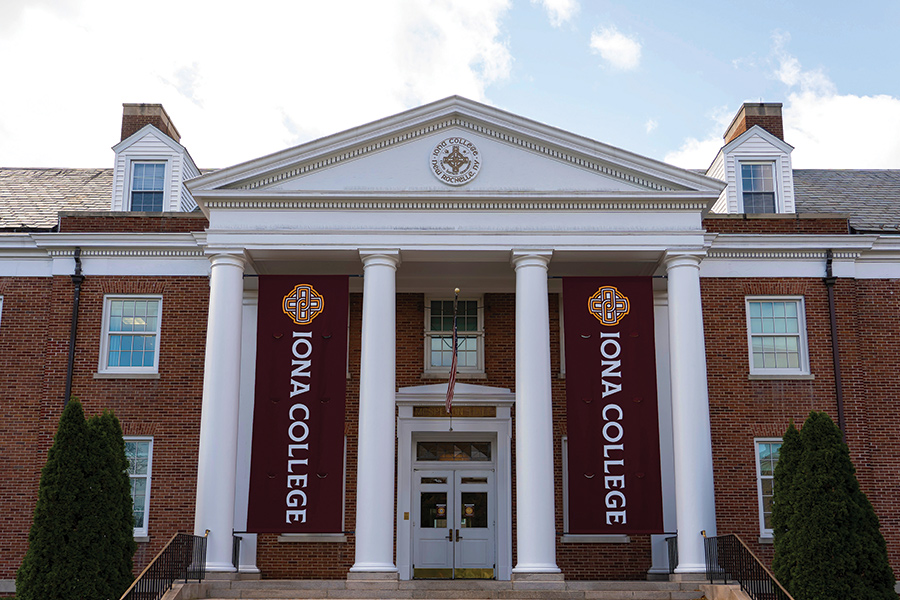 The main entrance of McSpedon Hall with the new Iona banners.